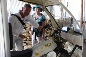 Joe Kinahan, Vice-President of Hamlin Fistula USA, examines the motorcycle cab with Helen.